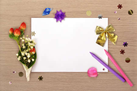The sheet of paper, the bunch, bow and the two pencils from above. Mockup