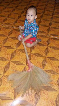 Little boy sweeping photo