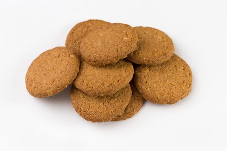 Pile of biscuits isolated on white background. Stock Photo