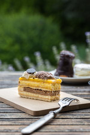 chocolaty: Sweet cakes with fork on rustic desk in the garden.