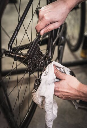 Road bicycle maintenance in service center.