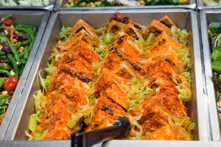 nappa: Fried tofu with nappa cabbage, salad in a pan in a food store Stock Photo