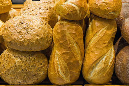 Bread on a stand in a bakery or food market photo