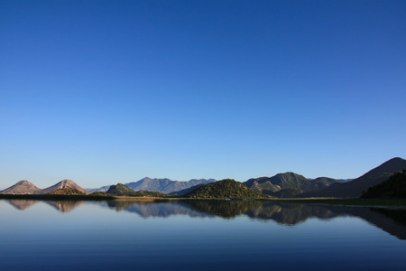 Blue sky and water of Lake Skadar, Montenegro photo