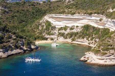Yacht and catamaran in a lagoon near Bonifacio, Corsica