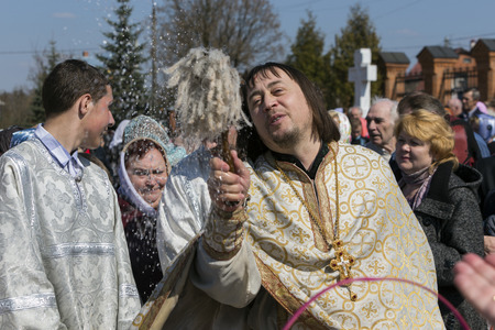 constantin: DARNA VILLAGE, ISTRA RAYON, RUSSIA, 2014, APRIL, 19  Orthodox priest father Constantin Volkov with his congregation during ceremony of consecration of Easter eggs and cakes for Easter Christ
