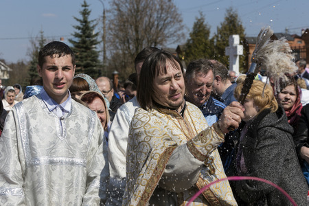 DARNA VILLAGE, ISTRA RAYON, RUSSIA, 2014, APRIL, 19  Orthodox priest father Constantin Volkov with his congregation during ceremony of consecration of Easter eggs and cakes for Easter Christ
