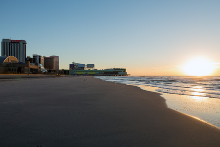 Atlantic City skylines, dunes and ocean shore at sunrise