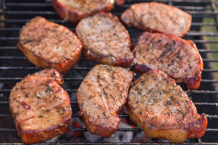 bbq pork chops finishing on the grill Imagens