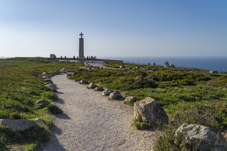 roca: Cliffs and lighthouse of Cabo da Roca on the Atlantic Ocean in Sintra, Portugal, the westernmost point on the continent of Europe, where the land ends and the sea begins.