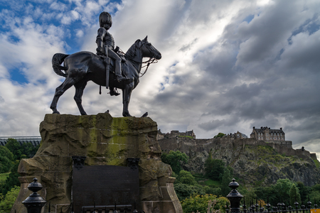 Royal Scots Greys Monument with Edinburgh Castle in the background from Princes Street Stock Photo