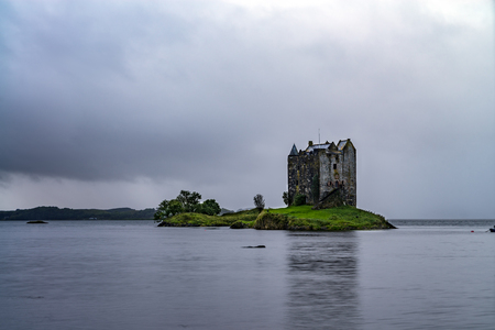 The ruins of historic Castle Stalker and view on Loch Linnhe