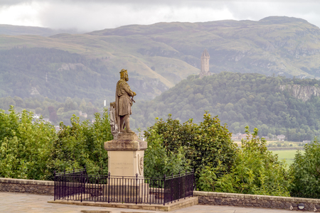 King Robert The Bruce Monument and Wallace Monument in the background at Stirling, Scotland 스톡 콘텐츠