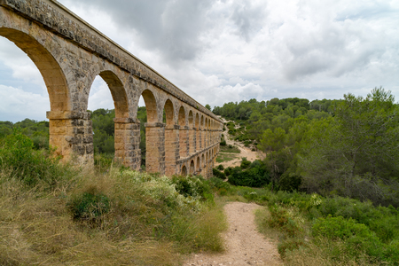 The beautiful and historic remains of the Roman Aqueduct named Pont del Diable (Devils Bridge) in Tarragona, Spain.