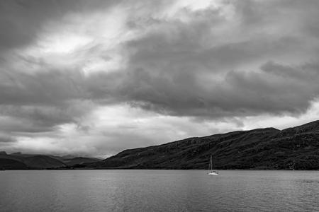 Small yacht on Loch Broom near Ullapool, Scottish Highlands  United Kingdom 写真素材