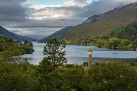 Glenfinnan Monument and Loch Shiel lake. Highlands Scotland Uk