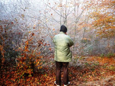 Man standing around autumn trees Stock Photo - 11272625