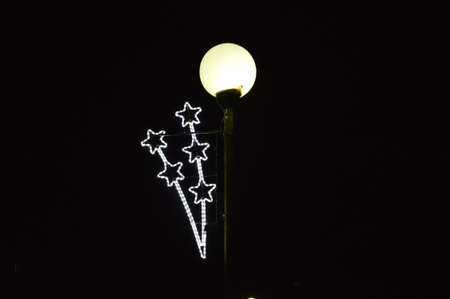 Decoratived stars lighting bulb to  street for holidays Christmas and New Year Stock Photo