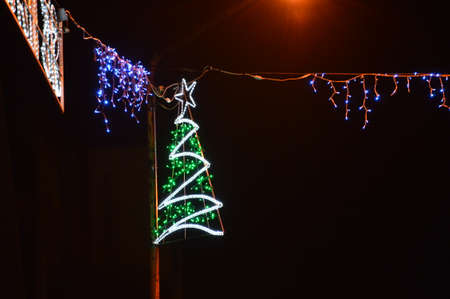 Decorated  christmas tree lighting bulb for holidays Christmas and New Year,this is de corated street Stock Photo