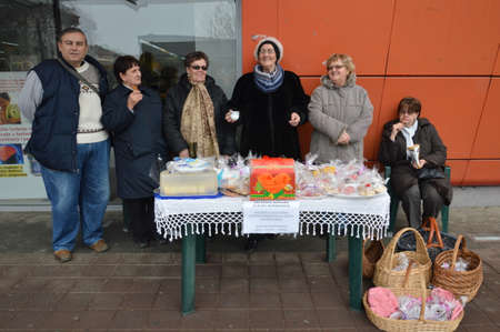 these woman and men are preparing cake for sale as a humanition action for a sick child in Bosnia and Herzegovina Editorial