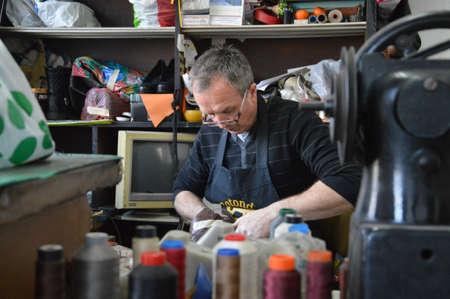 shoemaker men repairing mens and womans footwear in Bosnia and Herzegovina