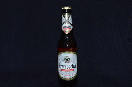 illustrative water drops on a bottle non alcoholic beer of a black backgrounds