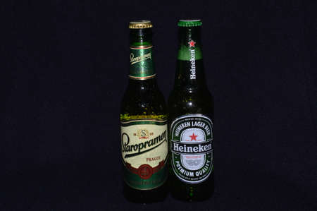 illustrative water drops on a bottle  alcoholic beer of a black backgrounds