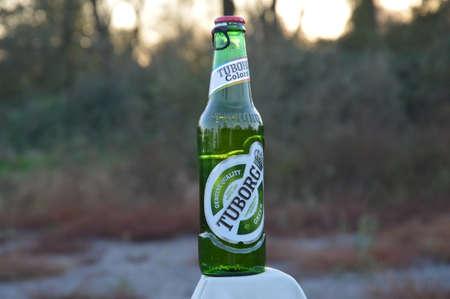 llustrative water drops on bottle beer Tuborg