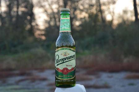 llustrative water drops on bottle beer Staropramen