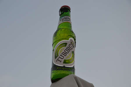 illustrative water drops on abottle beer  Tuborg of white backgrounds sky Editorial