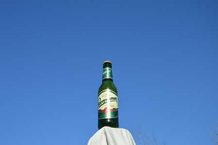 illustrative bottle beer  Staropamen of blue backgrounds sky