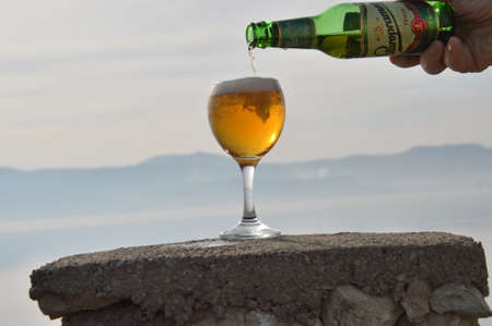 Beer in glass of the backgrounds  big lake in Bosnia