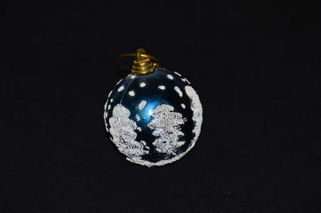 Balls on black background for Christmas and New Year,s tree