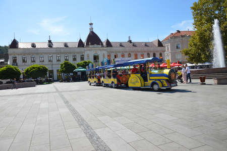 The quare of freedom in the city Tuzla, with fountain and tourist train