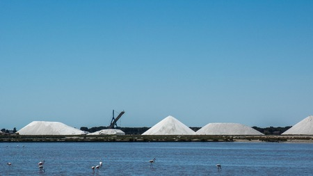 humid: Aigues Mortes, France - May 17, 2015: the sea salt saltworks of Aigues Mortes with equipment used for the storage of salt