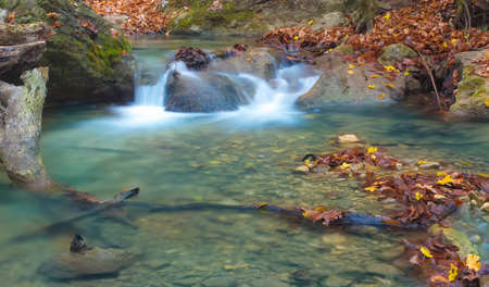 limpid: Little waterfall in Crimea mountains in autumn
