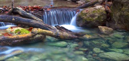 Little waterfall in Crimea mountains in autumn