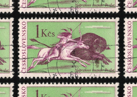 hunted: CZECHOSLOVAKIA - CIRCA 1966: A stamp printed in Czechoslovakia from the North American Indians - The 100th Anniversary of the Naprsteks Ethnographic Museum, Prague issue, shows a bison being hunted.