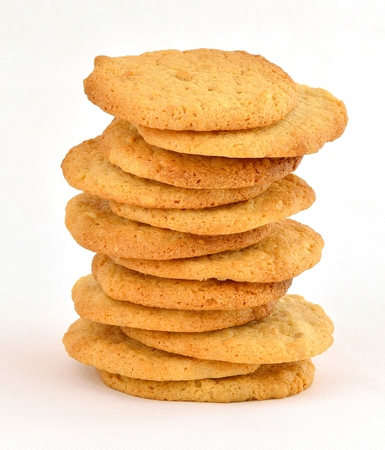 staggered: Staggered stack of homemade peanut butter cookies. On a white background.
