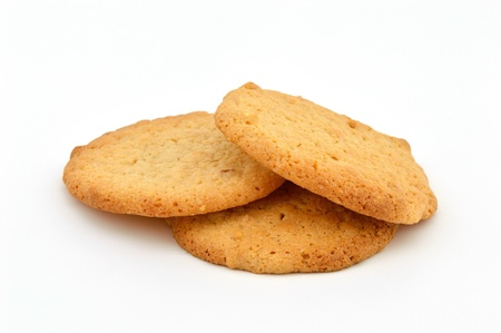 goodies: Three homemade peanut butter cookies on a white background.