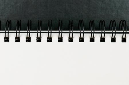sketchbook: Close-up of ring bound artists sketchbook. Blank page.