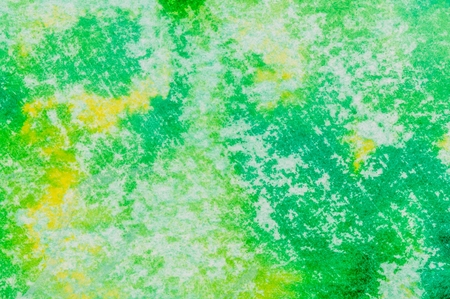 ink and wash: Yellow and green colored ink wash background with diagonal texture marks.