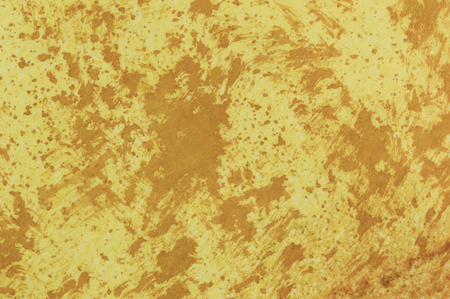smeared: Abstract grunge background. Cream and brown splashes and drag marks.
