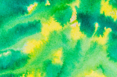 ink and wash: Yellow and green colored ink wash background with vibrant bleeding colors.