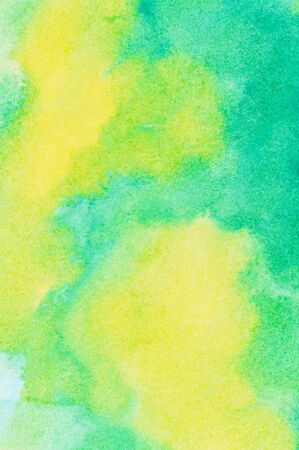 ink and wash: Soft yellow and green colored ink wash background.