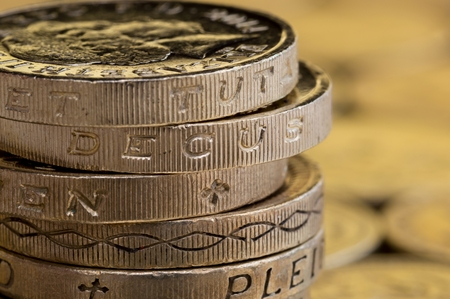 stacked up: Close up of British money, pound coins stacked up.