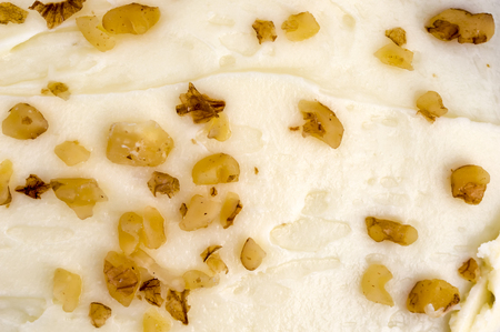 mouth watering: Mouth watering butter cream and walnut cake topping. Close up, background.