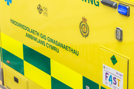 WREXHAM, UK - AUGUST 30, 2016: Detail of the side of a Welsh emergency service ambulance. Editorial