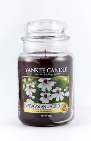 scent: WREXHAM, UK - OCTOBER 27, 2016: Yankee candle in a jar, floral Madagascar orchid scent. On a white background. Editorial