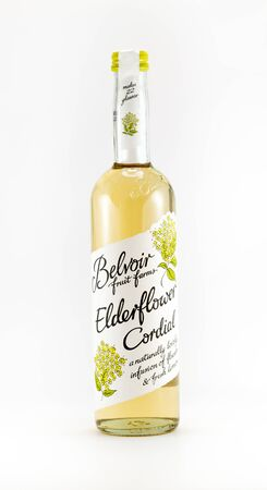 cordial: WREXHAM, UK - OCTOBER 27, 2016: Bottle of Belvoir Elderflower cordial on a white background.
